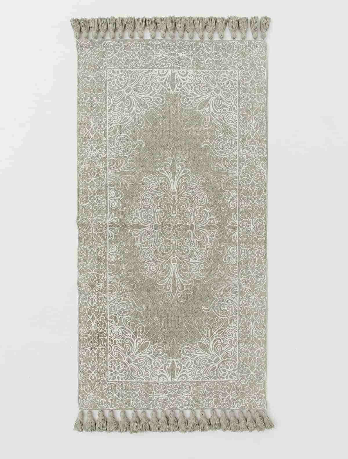 alfombras originales hm con borlas