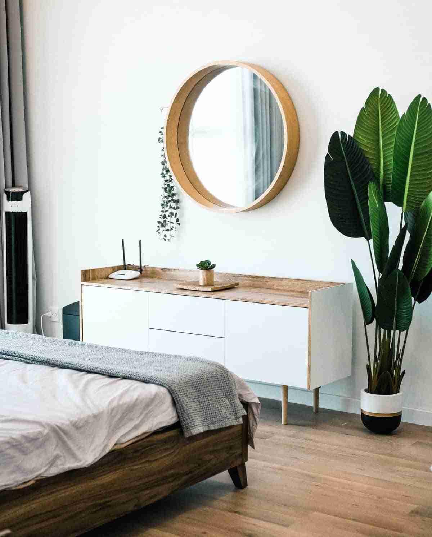 decorar dormitorios con espejos redondos