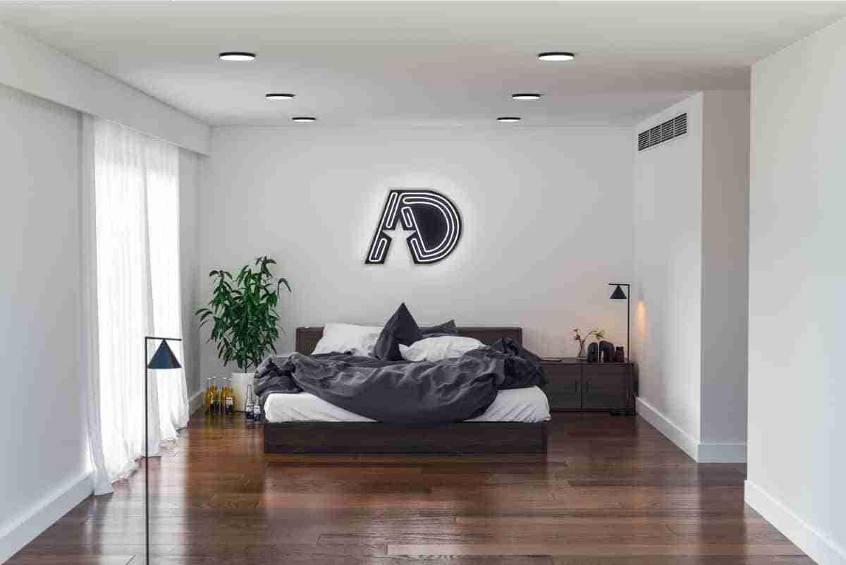 dormitorio masculino con camas al ras del suelo